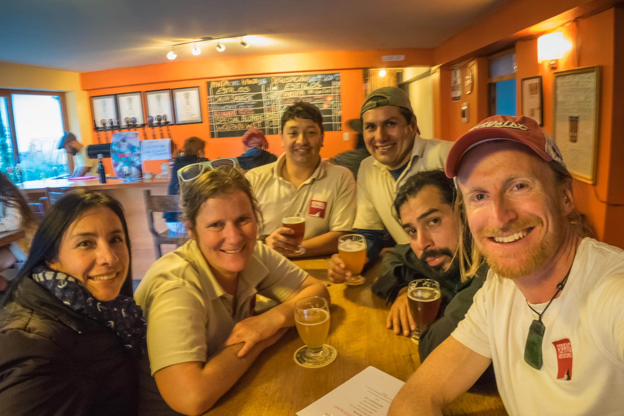 The team enjoys a beer after a day planning new Peru group tours
