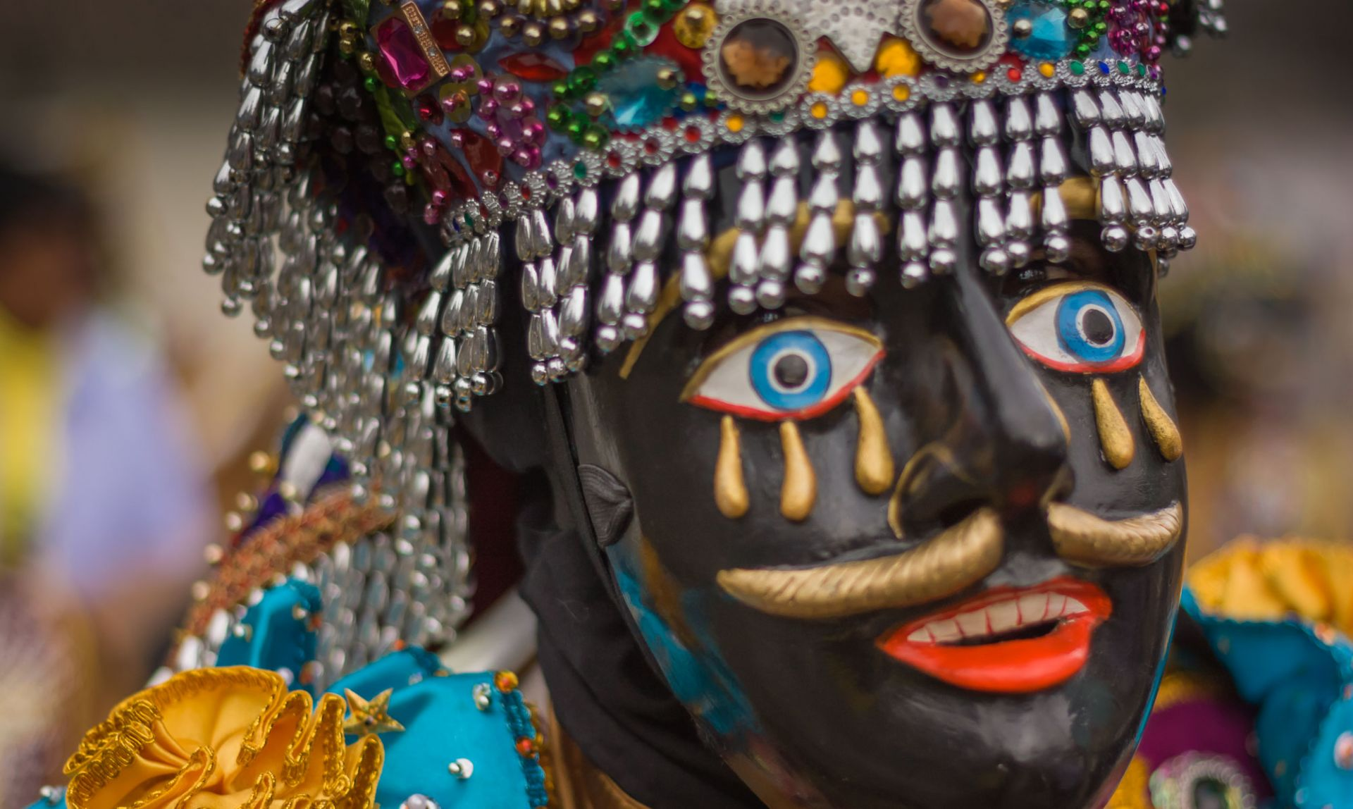 Close-up of man in elaborate negrillo mask, taken on our Paucartambo cultural tour