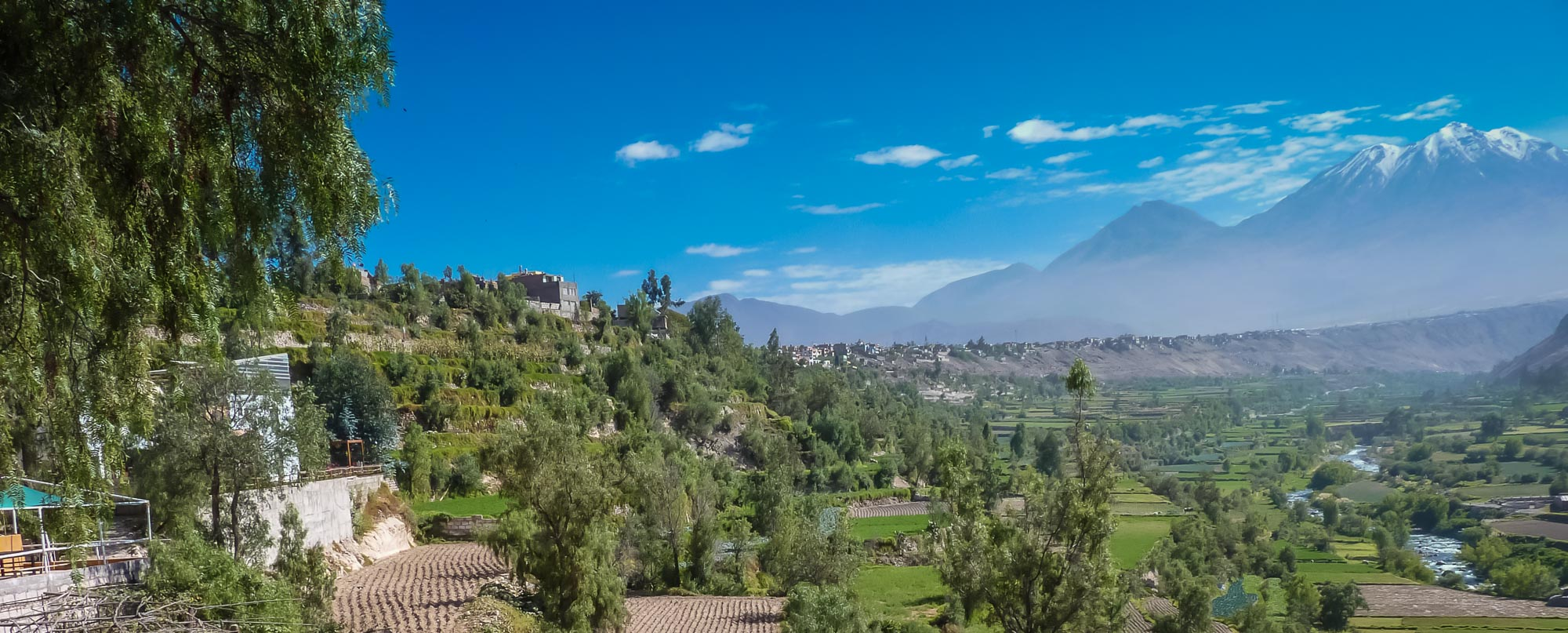 Lush green valley and active volcano seen from a private Peru tour to Colca Canyon