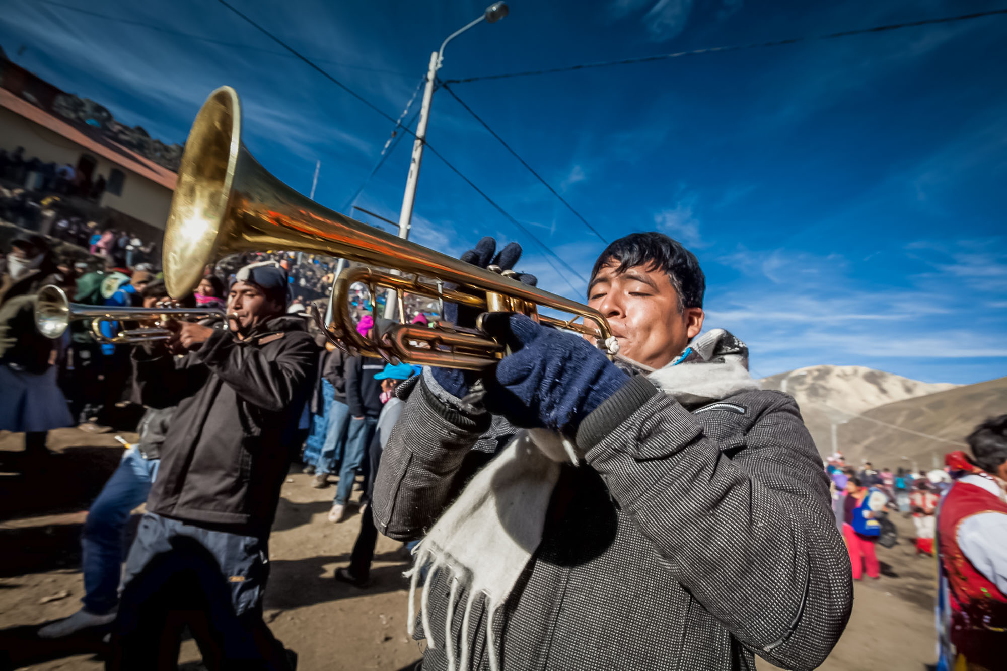 Trumpet player in a street parade we watched on a Peru adventure tour