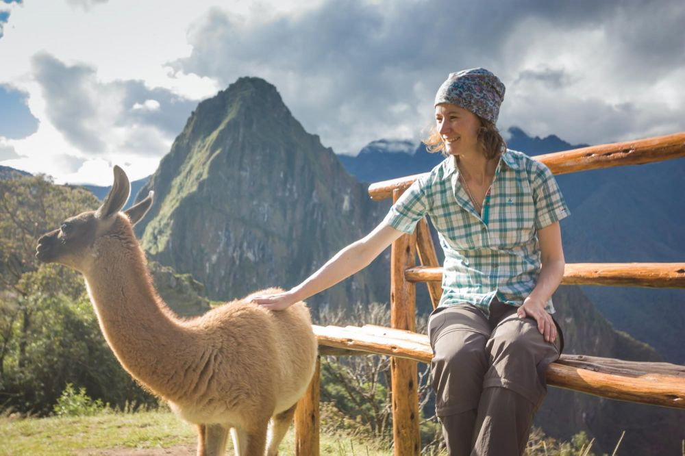 "A happy Aspiring guest ticks ""pat a llama at Machu Picchu"" off her bucket list!"
