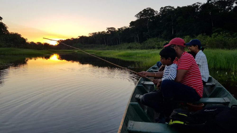 Our guests catching piranhas for dinner on the last night of the Peru family trip!